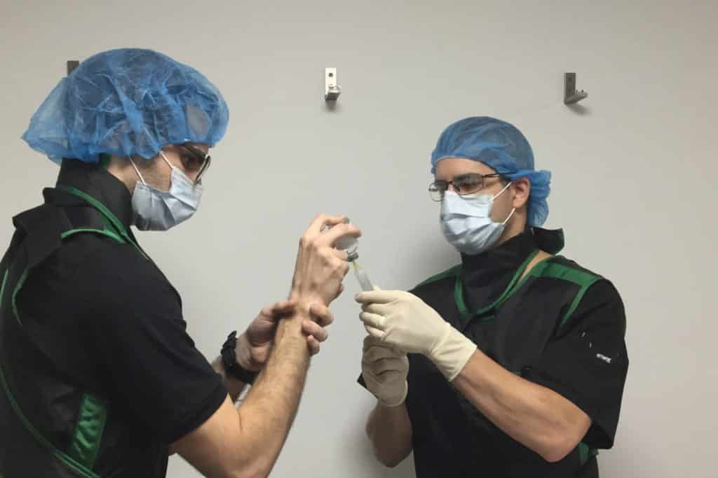 Doctors preparing an injection for PTSD